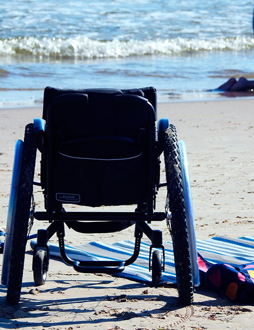 wheelchair-beach-ndis-support-service-provider